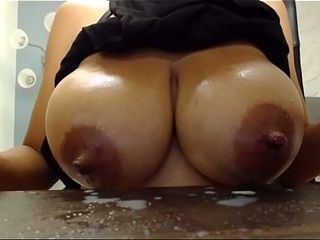 Web cam woman gargles her own boobies